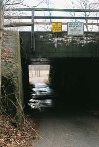 signs prohibit hunting and trespassing above the railroad underpass leading to Mariemont's lower 80 acres.